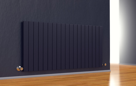 warmth: room with a modern radiator on a dark wall (3d render) Stock Photo