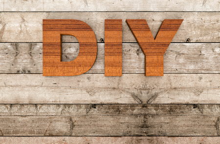 custom letters: top view of the word diy on wooden background, empty space at the bottom (3d render)