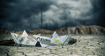 failed strategy: two paper boats made with banknotes on a puddle of water and dry ground, stormy sky, concept of financial crisis (3d render)