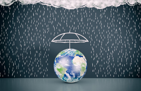 wall with the drawing of dark clouds and rain, one umbrella is protecting a world globe, concept of world security (3d render) - Elements of this image furnished by NASA