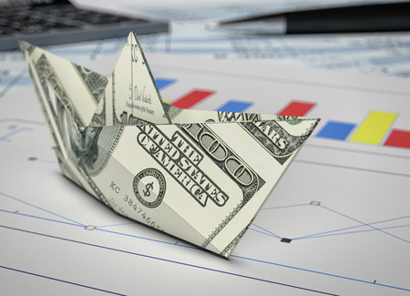 3d boat: one paper boat made with dollar banknotes, and a financial report document (3d render)