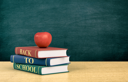 text books: three books with text: back to school and a red apple, chalkboard on background with empty space (3d render)