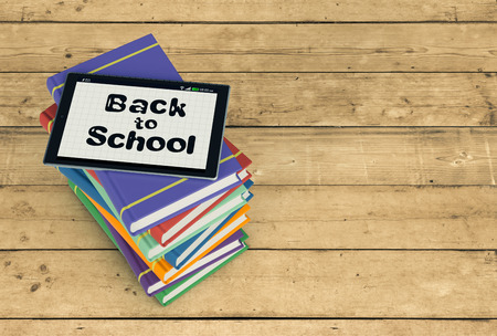 text books: top view of a stack of books with a tablet pc and text: back to school, wooden background, empty space at the right of the image (3d render)