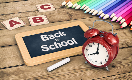coloured pencils: one chalkboard with a vintage alarm clock and a set of coloured pencils on wooden background, concept of back to school (3d render)