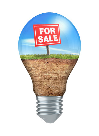 grass land: light bulb with land grass and signboard: for sale, white background (3d render) Stock Photo