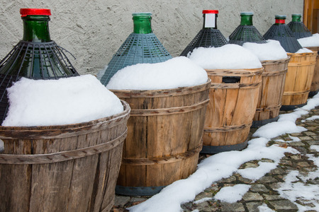 demijohn: wine carboys outside a tavern in winter Stock Photo