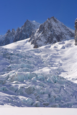 glacier of mont blanc in a blue sky day photo