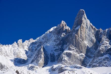 aiguille: aiguille du dru famous peack of europen alps in a blue sky day Stock Photo