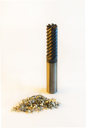 end mill  with aluminium shavings white background vertical