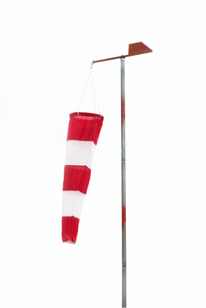 wind down: wind sock hanging down in a no wind day white background