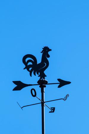 windward: irony weather cock on a  blue sky background