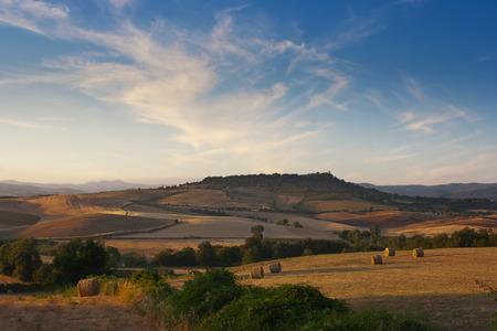 fields of tuscan maremma near saturnia italy at sunset Archivio Fotografico