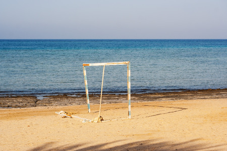 goalpost: old goalpost in a tropical beach abandoned without the net Stock Photo