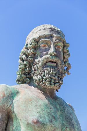 Portrait of Riaces Bronze copy of statue A. blue sky background