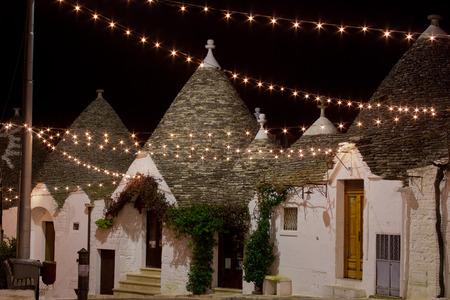 trulli: Alberobello trullo at night decorated with hundreds of littlestarry  lights Stock Photo