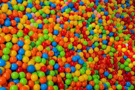 pool ball: lots of colored balls in a playground ball pool