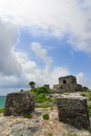 ruins of God of winds mayan temple on a cliff overlooking blue torquoise ocean in Tulum Quintana Roo Mexico