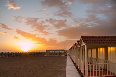 Forte dei Marmis beach cabin while the sun is setting