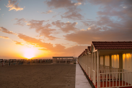 forte: Forte dei Marmis beach cabin while the sun is setting