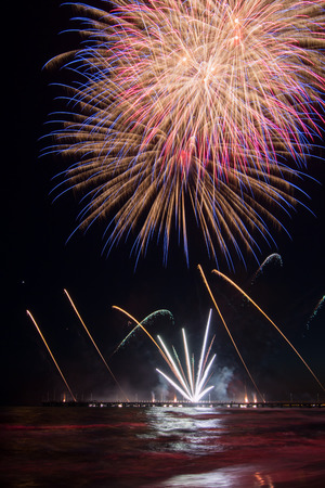 pyrotechnic show fireworks reflecting in the water during australia exhibition at International Fireworks Festival In Forte dei Marmi