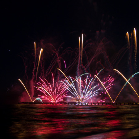 pyrotechnic show fireworks reflecting in the water during australia exhibition at International Fireworks Festival In Forte dei Marmi square format