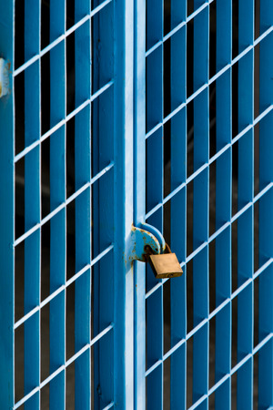 padlocked: square shaped grates locked with a padlock painted in light blue