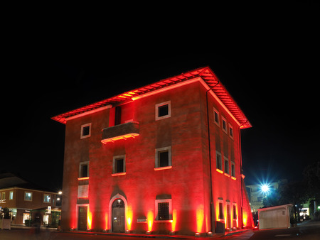 a nocturne: Fortino the symbol of Forte dei Marmi by night enlightened with red light in Christmas Holidays Editorial