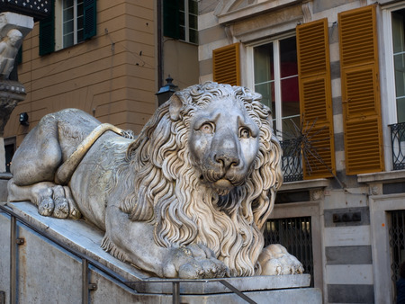 smutty: Old Marble Statue of a big proud lion outside Genoa Cathedral Saint Lawrence. Made by artist Rubatto in 17th century