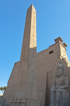 obelisk stone: Egyptian Obelisk and statue at the entrance of the Temple of Karnak Luxor ancient Thebes