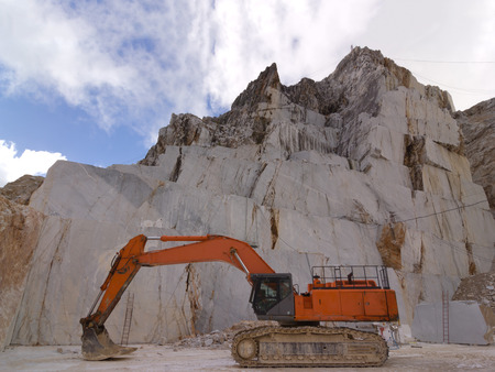 cingulate: Orange cingulate Excavator in a white marble Carraras quarry in Apuan Alps Stock Photo