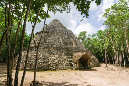 roo: Xaibe or Crossroads or painting Temple observatory in Mayan archaeological site of Coba Quintana Roo Mexico. Surrounded by tropical jungle Stock Photo