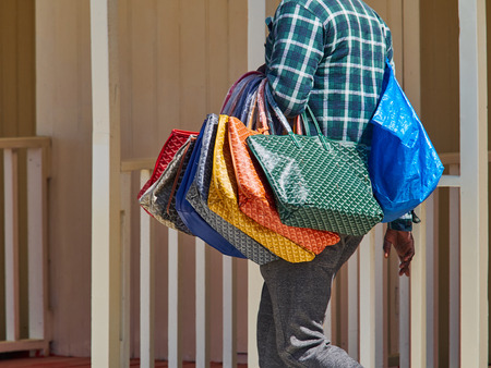 forte: Group of fake bags sold by African Immigrant Forte dei Marmi Versilia Tuscany Italy