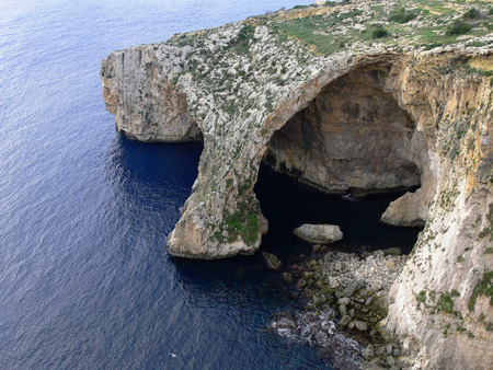 brilliant   undersea: Natural Arc of Blue Grotto cavern on the south coast of Malta viewed from the top of steep cliff