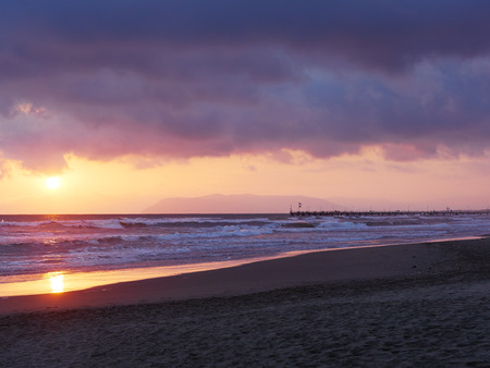 forte: terrific colorful sunset at Forte dei Marmi. Famous pier and Liguria coastline in Background