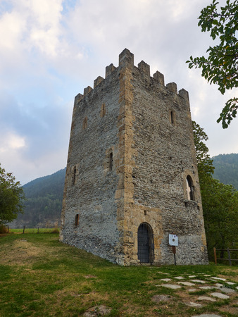 crenellated tower: Oulx, Italy _ October  03, 2016 Medieval square crenellated tower called Delfinale or Saracena Stock Photo