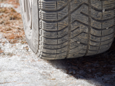 driving conditions: winter tire with peebles in the grooves on  ice