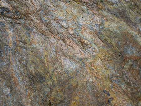 close up detail of Metamorphic rocks with colorful mineral streaks.   Texture - background Stock Photo