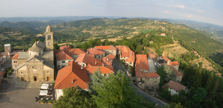 Aerial view of Roccaverano and Langhe country landscape in background. Santa Maria Annunziata church on the left