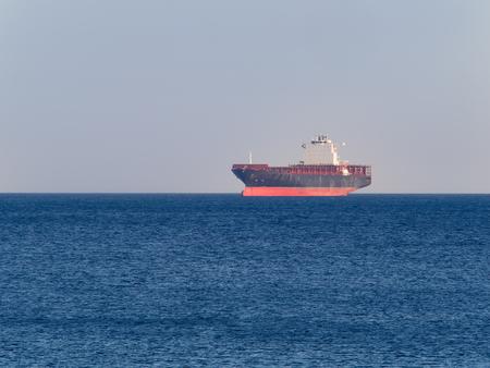genoa: Genoa, Italy _ June  08, 2017: Empty Container  cargo ship UASC Bubiyan anchored off the harbor awaiting  loading Editorial