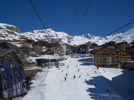 Val Thorens, France _ March  18, 2017: Ski slope and chairlift in Val Thorens, people skiing in the middle of the village Stock Photo