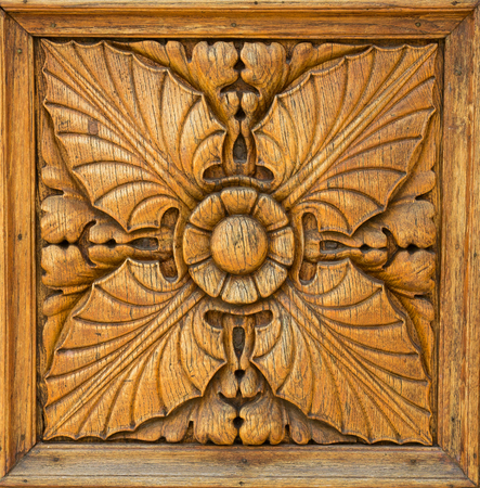 square wood panel hand carved with flower and plant shapes more than a hundred years old