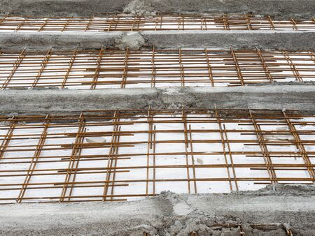 steel grids used with concrete on a construction site to reinforce the floor structure