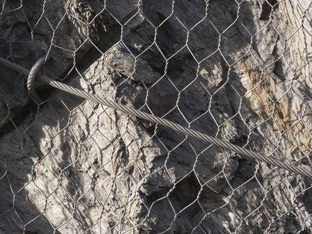 detail of metal mesh and wires used to protect mountain roads from landslide and rockfall