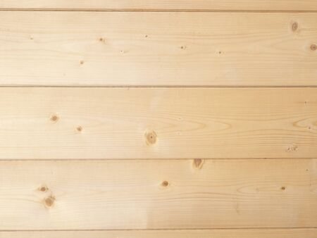 background of three light brown pine wood planks arranged horizontally