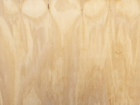 background created from a  striated light brown  plywood board Archivio Fotografico