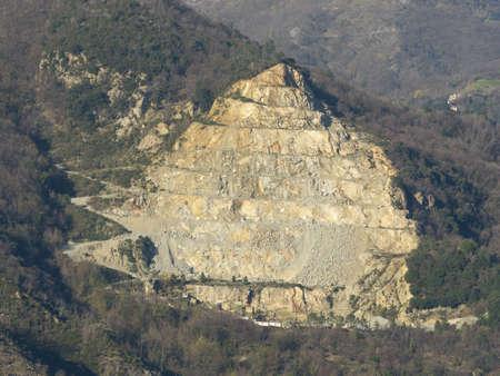 Genoa Italy_March 14, 2020:  stone (dolomites, dolomitic limestones) quarry on the side of a mountain (monte Gazzo) Editoriali