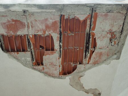 Ceiling Damaged after a weak earthquake, cement plaster and brick have fallen Foto de archivo