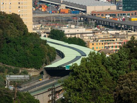 sound-absorbing tunnel to limit the noise of the highway passing in the middle of the city next to buildings