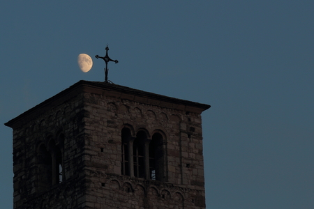 at sunset the moon ago reverence to the bell tower