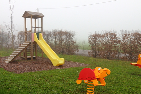 kids park on foggy winters day